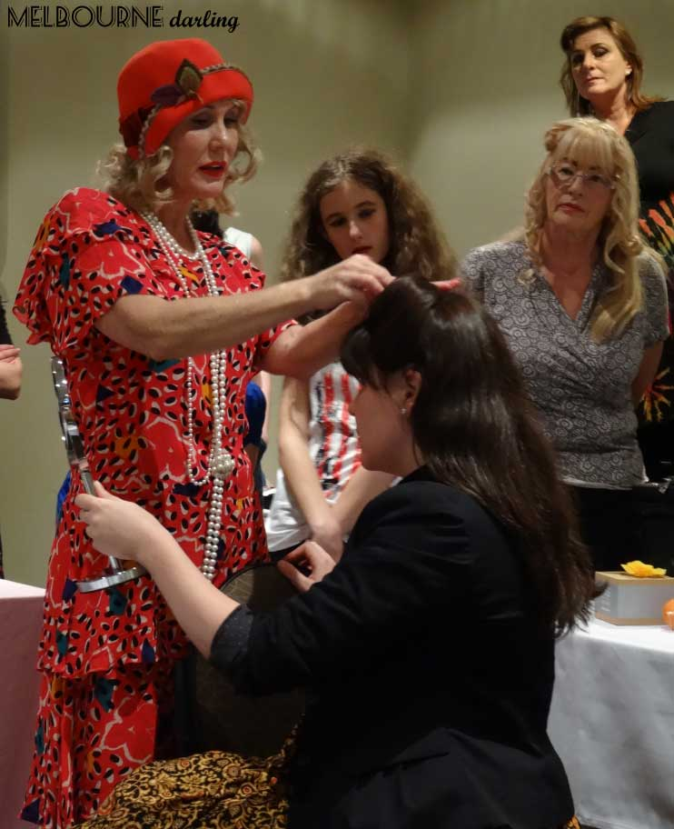Chrissy conducting a hair tutorial at one of her workshops